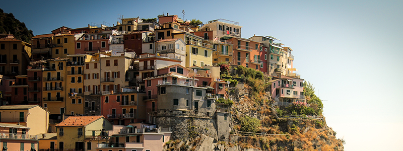 Colourful buildings on top of a hill in Italy