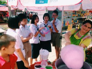 Students eating candyfloss in Thailand