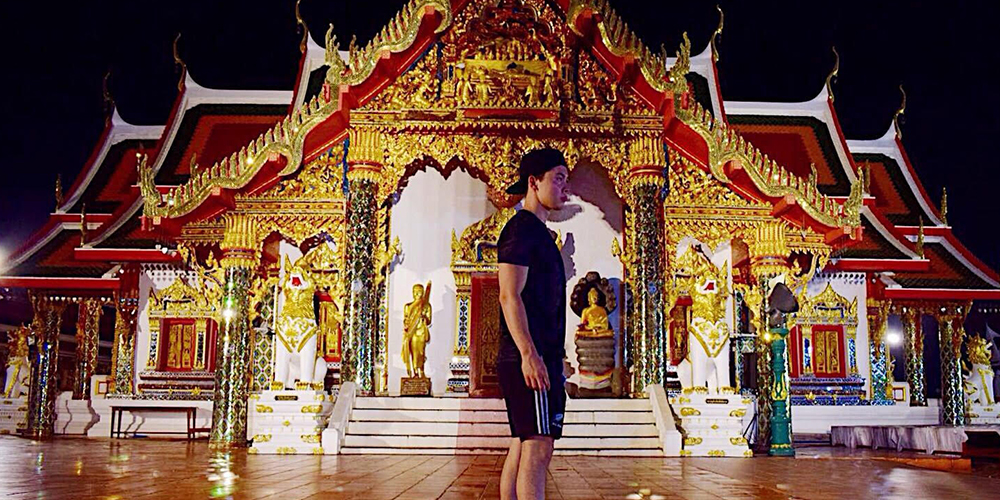 James standing in front of a temple in Thailand